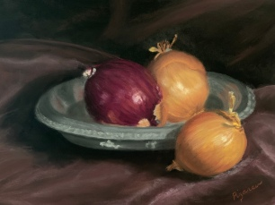Onions on a pewter plate